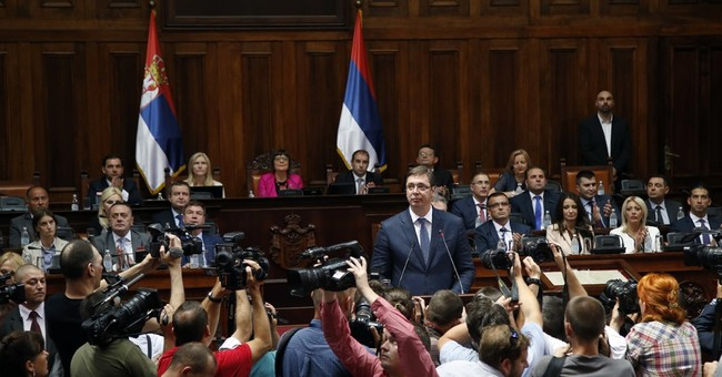 Serbia's first gay minister wants less public attention