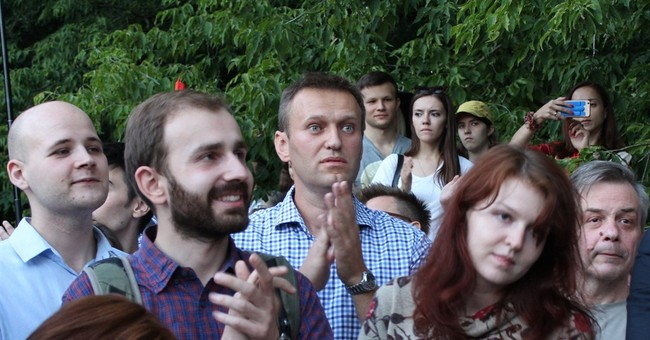 Russian opposition supporters protest new repressive law