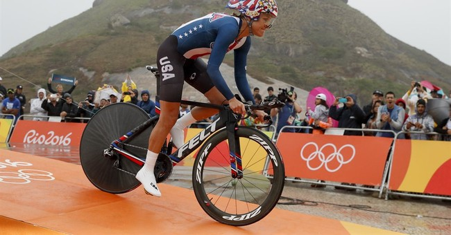 The Latest: Cancellara denies Froome time trial gold at Rio