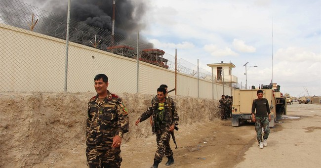 Afghan official: Taliban closing in on key city in the south