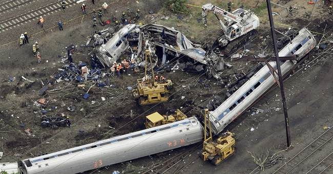 APNewsBreak: Amtrak settlements silencing crash victims
