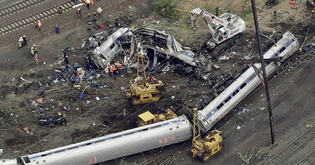 APNewsBreak: Amtrak settlements silencing crash victims