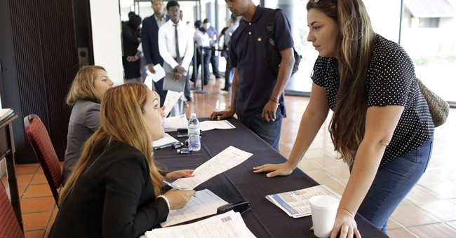 US employers advertised more jobs and boosted hiring in June