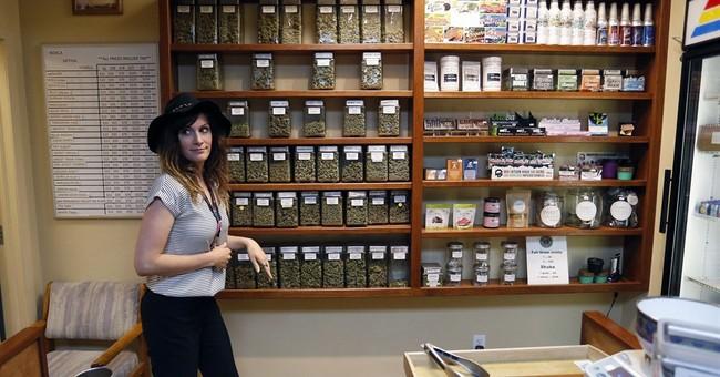 US government won't reclassify marijuana, allows research
