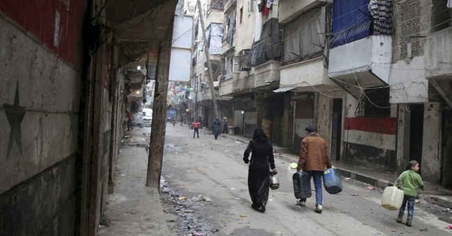Airstrikes in Syria's Aleppo hit hospital, market, kill 18