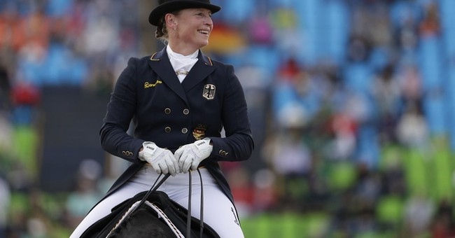 Werth most successful Olympic rider as Germany wins dressage
