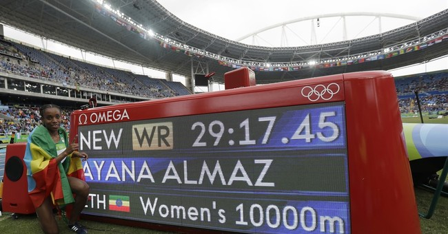 Ayana sets world record to open Olympic track program