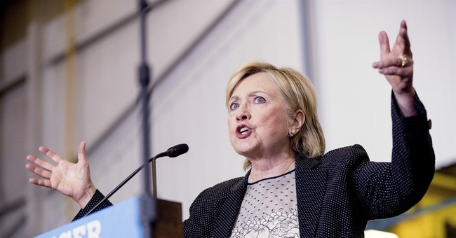 Clinton releases 2015 tax returns, pushing Trump for his