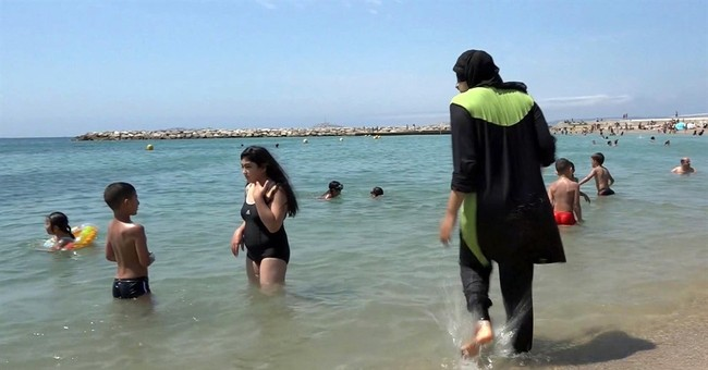 Third French town bans 'burkini' swimwear after tense clash