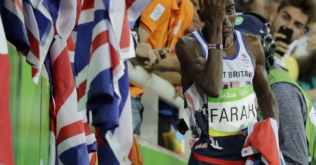 Not even a crash can stop Farah over 10,000 at Olympics