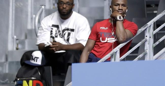 Floyd Mayweather checks on next generation of Olympic boxers