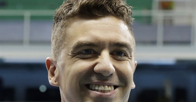 Ervin pulls off Olympic swim victories 16 years apart