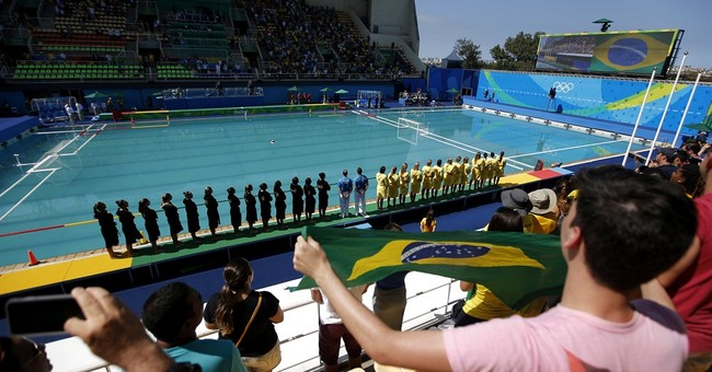 Out of options, Olympic officials drain green pool
