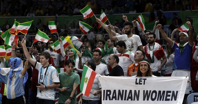 Olympic security asks female Iranian fan to drop sign