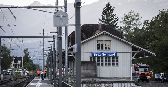 Swiss police report stabbings, fire on train; suspect held