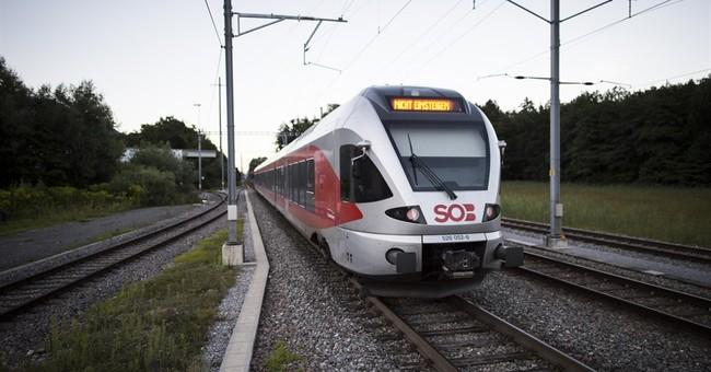 Swiss police report stabbings, fire on train; suspect held