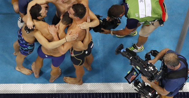 In Olympics, a first for Puerto Rico _ and 23rd for Phelps