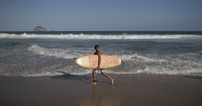At a school in Rio's slums, kids surf in toxic waters