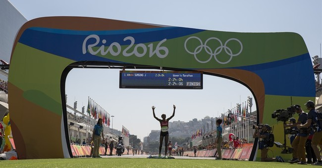 A win is secured for Kenya's Sumgong in women's marathon