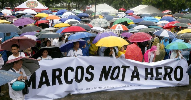 Hundreds protest hero burial for Philippine dictator Marcos