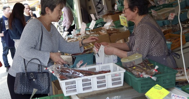 Japan's economy slows to snail's pace as exports falter