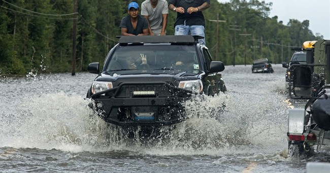 The Latest: Body pulled from floodwaters in Baton Rouge