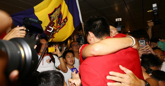 The 'golden boy' Schooling mobbed on return to Singapore