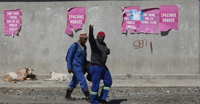 South Africa marks mine shootings, workers still in squalor