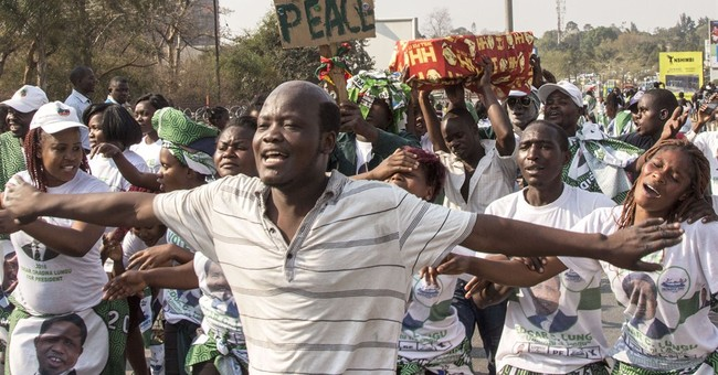 Zambia's president re-elected in close vote after violence