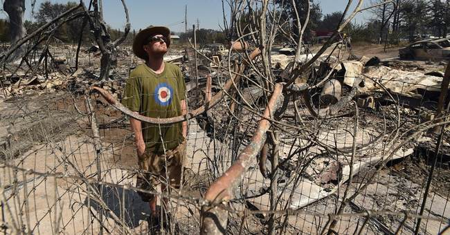 Man arrested for arson blaze that decimated California town
