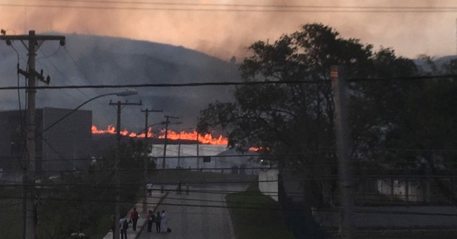 Brush fire near Olympic sites rains down ash