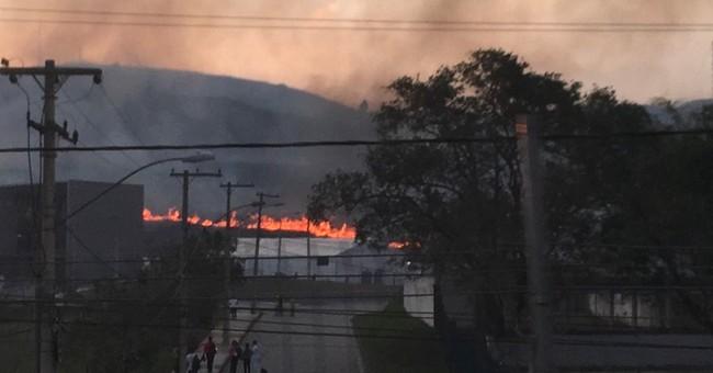 Brush fire near Olympic sites rains down ash
