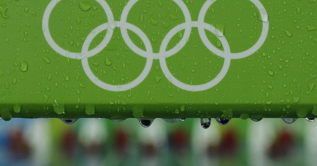 Foul weather hits Olympics, on the track and at sailing