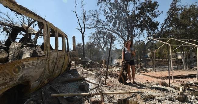 The Latest: California fire destroys dozen buildings