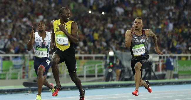 Usain Bolt's mid-race smile celebrated by meme makers
