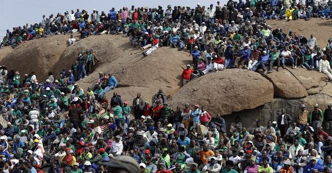 Thousands of miners mark South Africa shooting anniversary