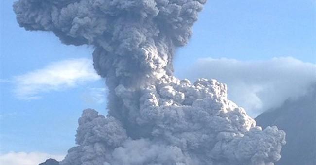 Guatemala's Santiaguito volcano spouts ash plume
