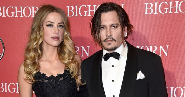 The Latest: Depp and Amber Heard issue joint statement
