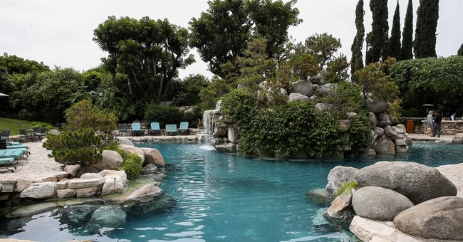 Sold! New Playboy Mansion owner closes deal for $100 million