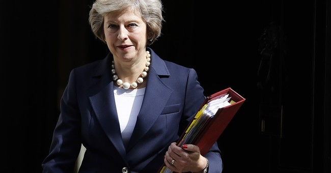 UK's May reassures China after nuclear power plant delay