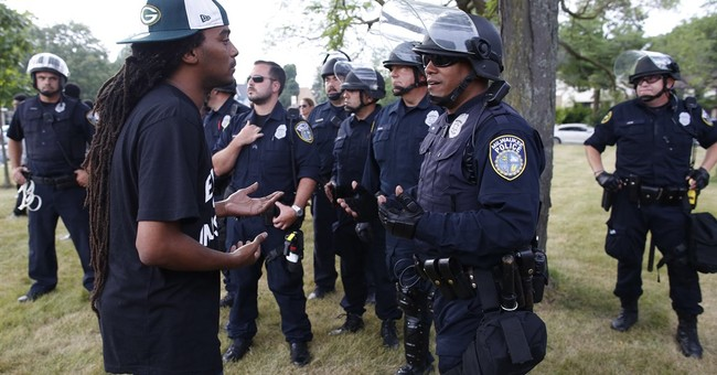 The Latest: Black Panthers meet city leader over unrest