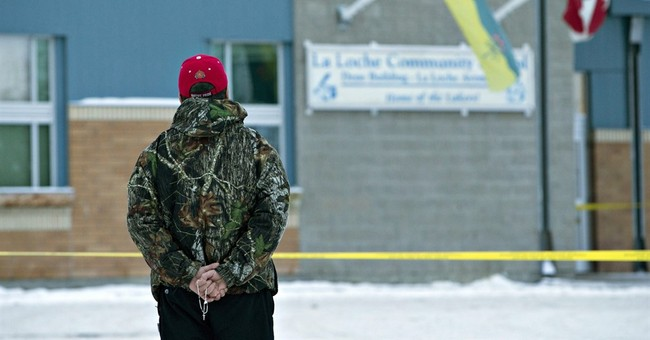 Police charge 17-year old in Canada after 4 shot dead