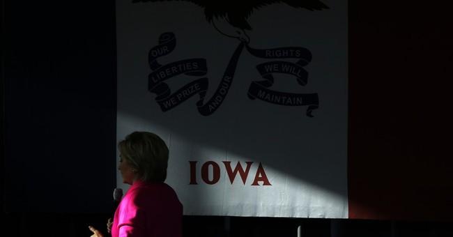 Clinton dials back attacks on Sanders as Iowa caucuses near