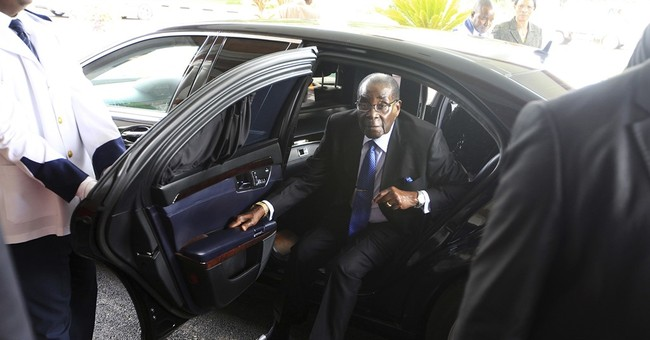 Zimbabwean President Robert Mugabe returns home