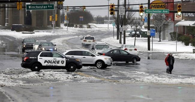Massive snowstorm brings flooding to East Coast