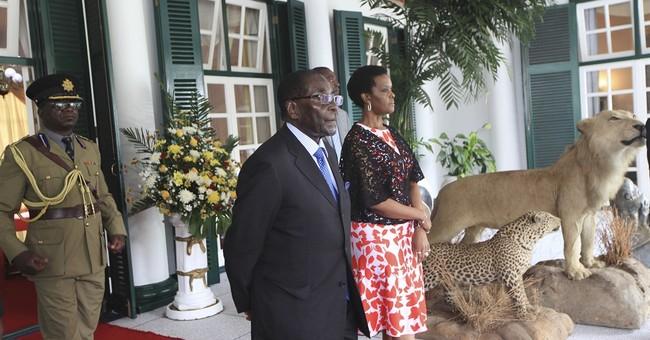 Zimbabwean President Robert Mugabe returns home