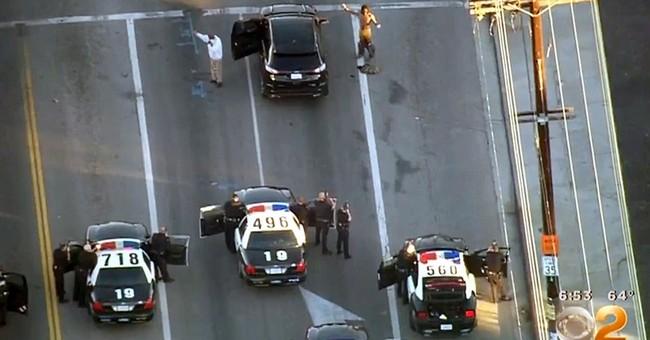 Los Angeles police detain 2 in investigation of armed men