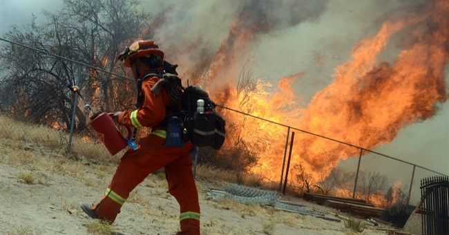 The Latest: Olympic fencing 'armorer' lost house in wildfire