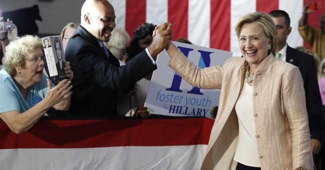 Clinton shrugs off Trump shakeup, attacks his tax plan