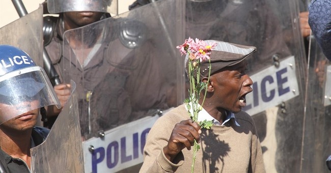 Zimbabwe police break up protest with tear gas, water cannon